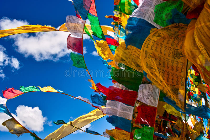 Prayer flags. Waving in the sky royalty free stock image