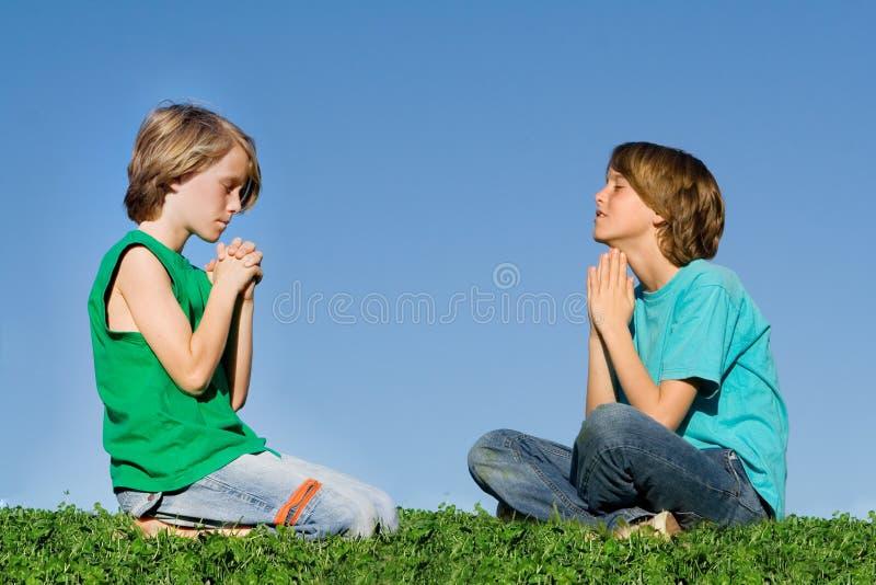 Prayer group children praying stock images
