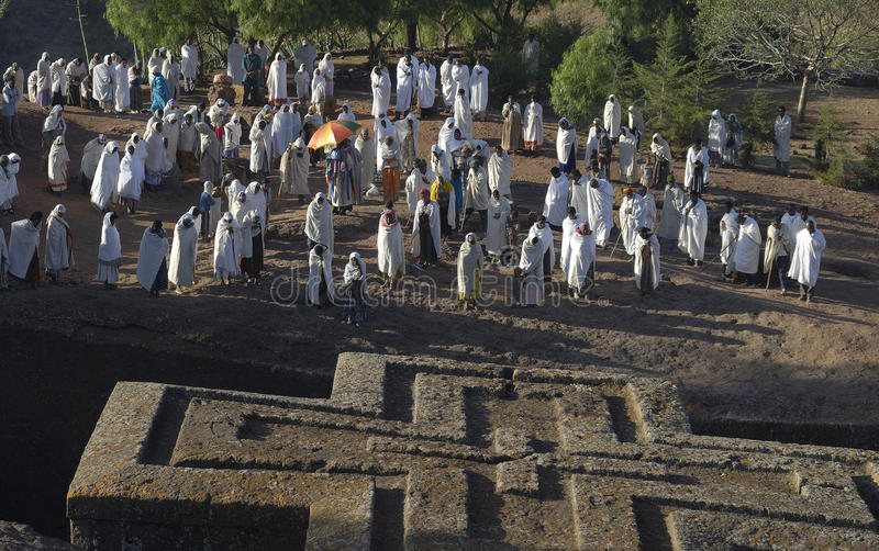 Prayer at the Lalibela Church. Believers gather for prayer at the rock-hewn church of Betis Giorgis in Lalibela, Northern Ethiopia stock images