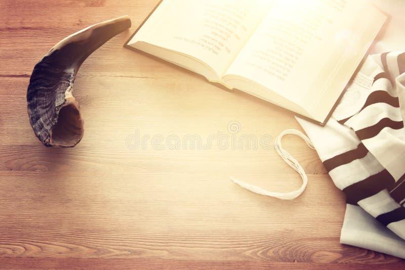Prayer Shawl - Tallit, Prayer book and Shofar horn jewish religious symbols. Rosh hashanah jewish New Year holiday, Shabbat an stock photo