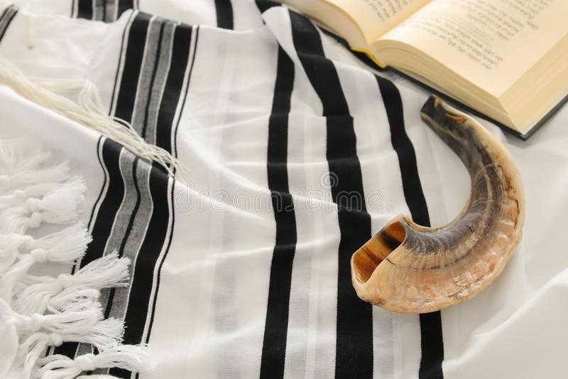 Prayer Shawl - Tallit and Prayer book jewish religious symbols. Prayer Shawl - Tallit, Prayer book and Shofar & x28;horn& x29; jewish religious symbols. Rosh stock photography