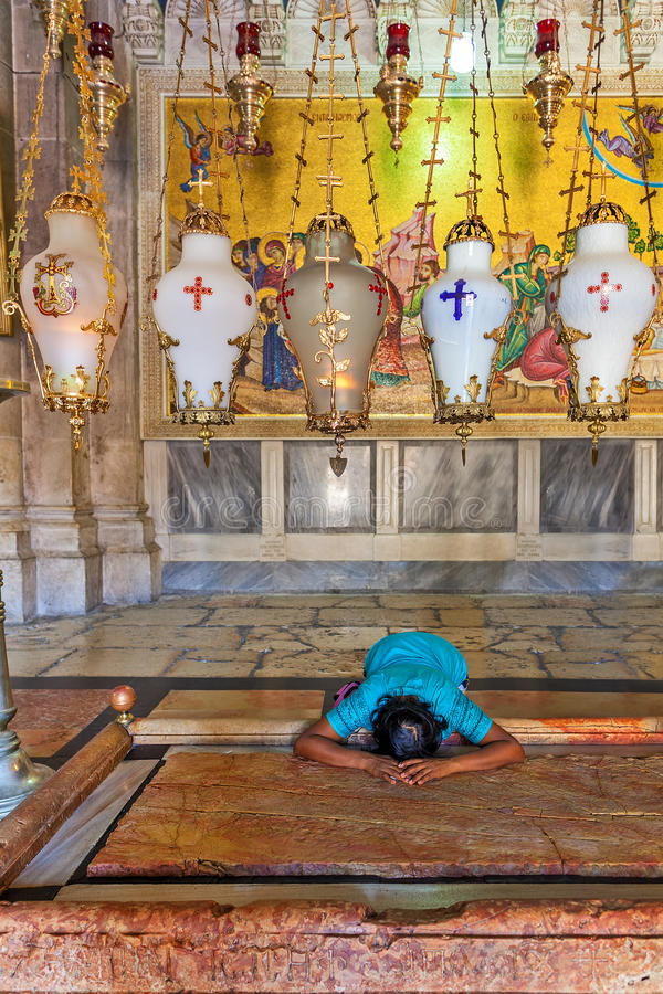 Prayer at Stone of Anointing at the entrance to the Church of the Holy Sepulchre in Jerusalem. stock photos