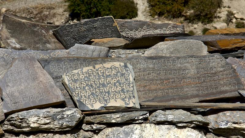 Prayer stone tablets - often found in the Himalaya royalty free stock images