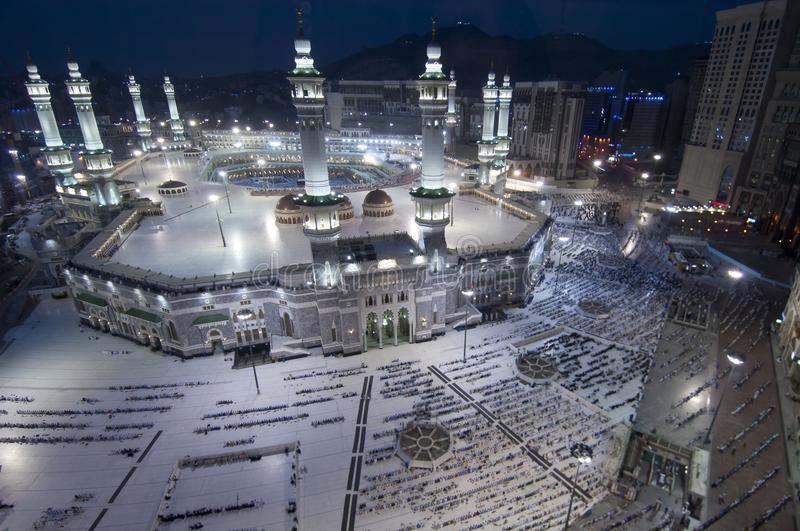 Prayer and Tawaf of Muslims Around AlKaaba in Mecca, Saudi Arabia. Aerial Top View stock photography