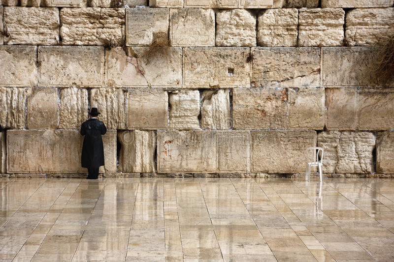 Prayer at Western Wall. Image depicts devotion of a Jewish man praying at the Western Wall in Jerusalem
