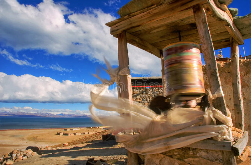 Prayer wheel on the banks of Lake Manasarovar royalty free stock images