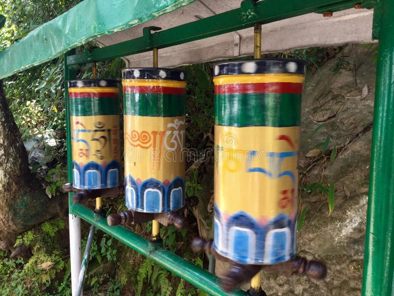 Tibetan Prayer Wheels in motion, the Kora Walk , McLeodgange, Dharamsala, India. A prayer wheel is a cylindrical wheel on a spindle made from metal, wood, stone stock photos