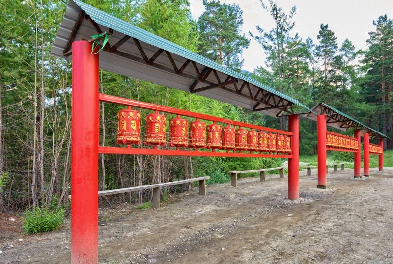 Prayer wheel. Tibetan Buddhist tradition royalty free stock photos