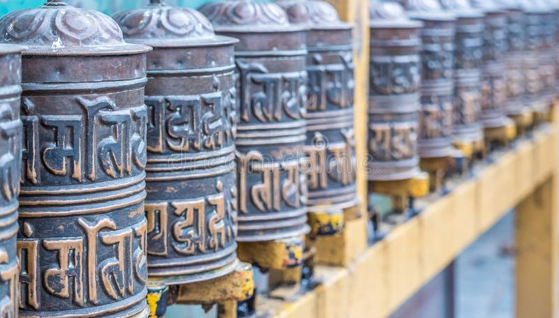 Prayer wheels in the buddhist temple stock photos