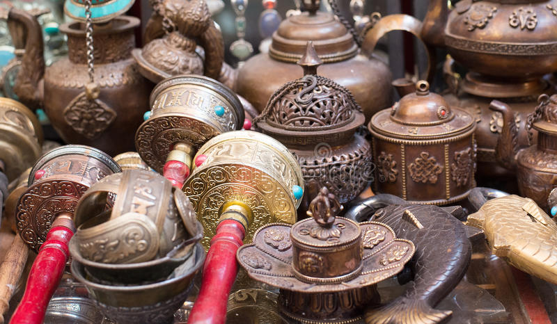 Prayer Wheels and handicraft wares at the market stock photos