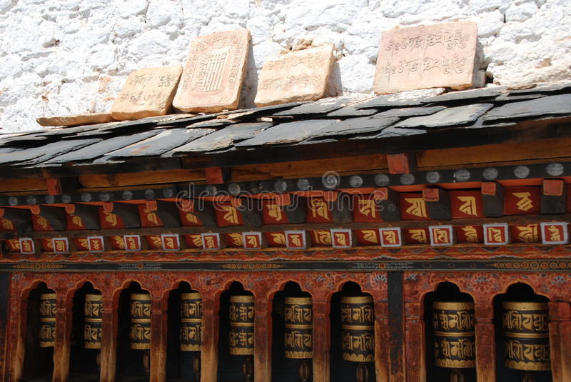 Prayer Wheels and Rock Engraving stock image