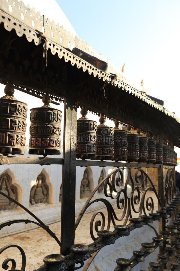 Prayer wheels at swayambhunath temple royalty free stock photo