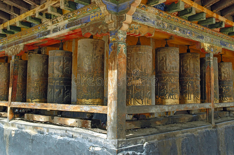 Prayer Wheels In Tibet. Old prayer wheels in Tibet royalty free stock images