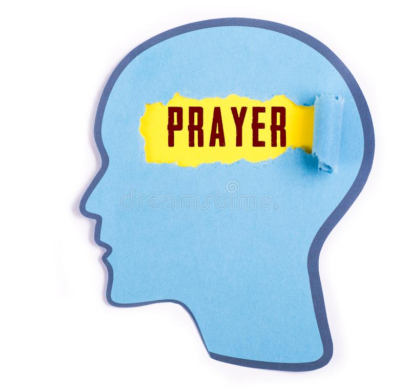 Prayer word in the person head. Prayer word text in the person head , torn blue paper and Paper head concept Thoughts inside the brain stock photos