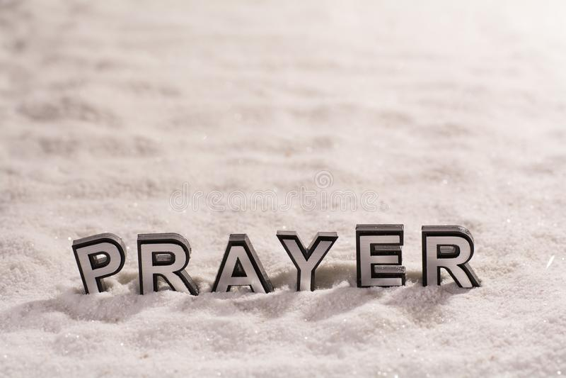 Prayer word on white sand royalty free stock photo