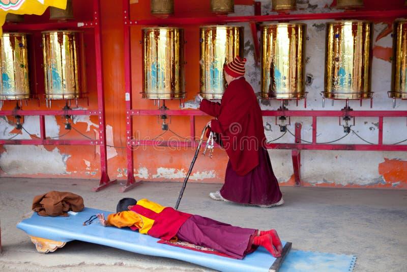 Prayers whirling prayer wheel in the Sertar buddhish college stock photos