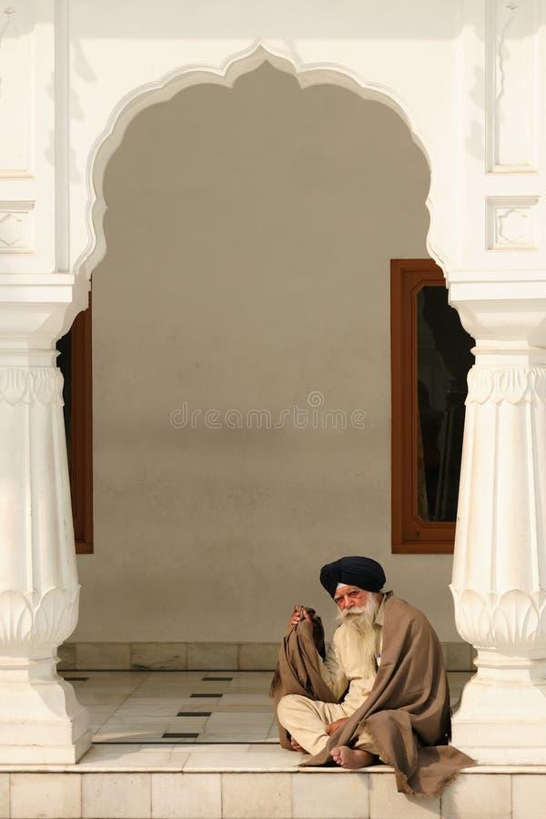 Praying in Amritsar. INDIA, AMRITSAR - DECEMBER 01: Praying pilgrim in the Golden temple (Sri Harimandir Sahib), Amritsar in Secember 01, 2009 royalty free stock image