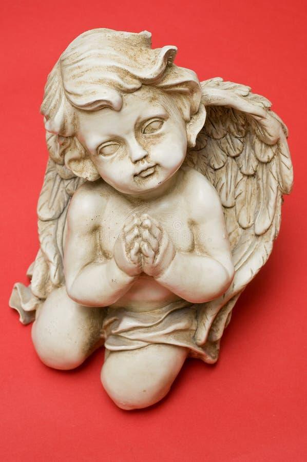 Praying angel looking towards