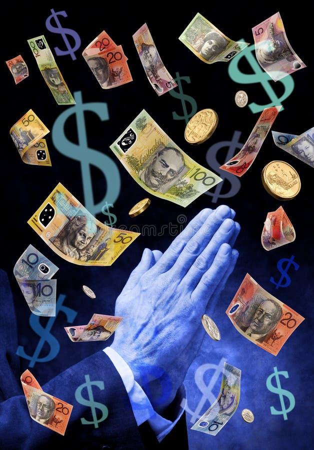 Praying For Australian Money. A mans hands praying with Australian money raining down stock photo