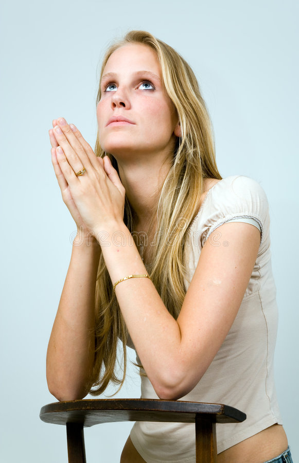 Praying Blond Girl. Stock Image