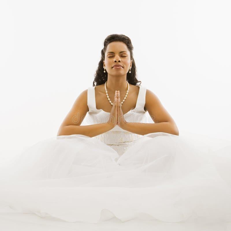 Praying bride. royalty free stock image