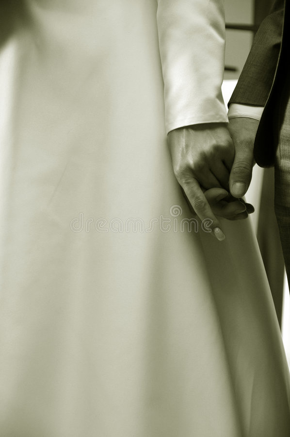 Praying bride and groom stock photos