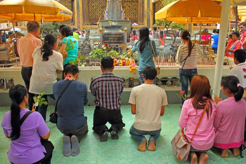 Praying Buddhists Editorial Stock Photo