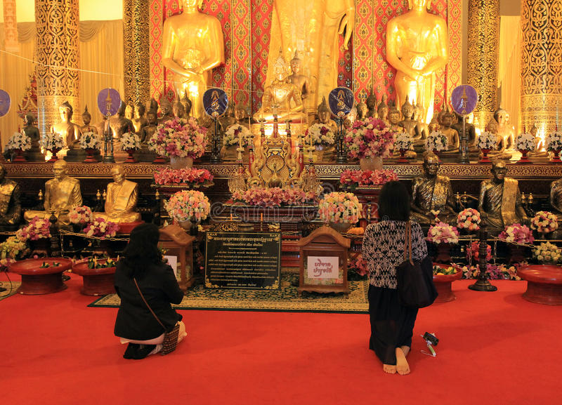 Praying at a buddhist temple, Thailand stock images