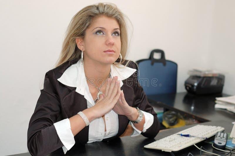 Praying businesswoman stock image
