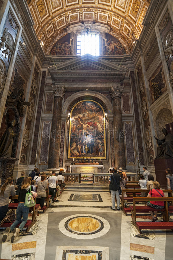 Praying in the cathedral. Vatican City 05-16-2015: people goes to Saint Peters cathedral because it is the house of christianity. Inside there are altars royalty free stock images
