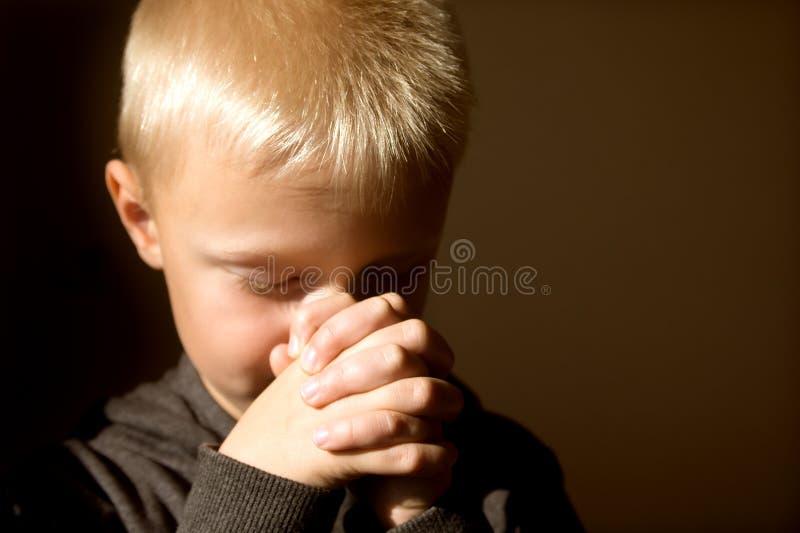 Praying child stock photos