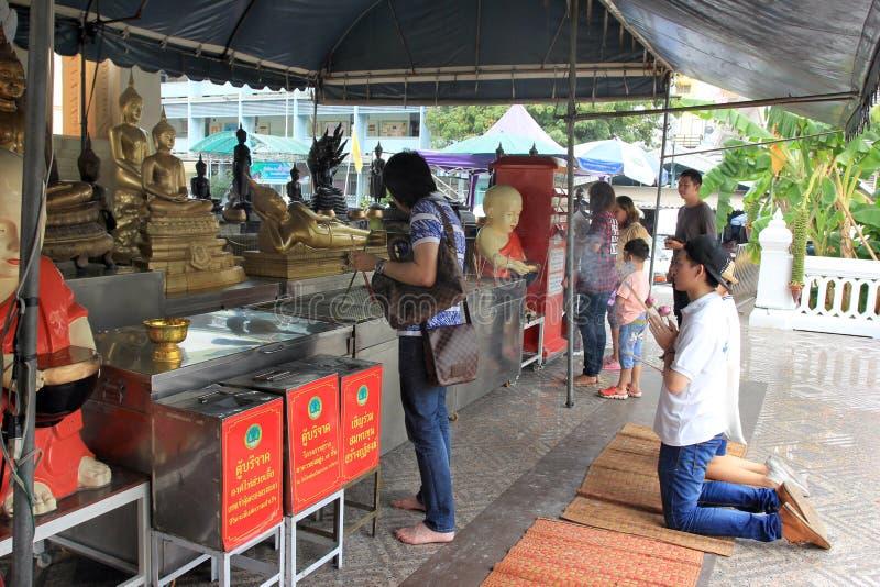 Praying at a chineese buddhist temple of Golden Buddha, Wat Traimit royalty free stock image