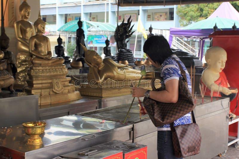 Praying at a chineese buddhist temple of Golden Budda, Wat Traimit royalty free stock photo