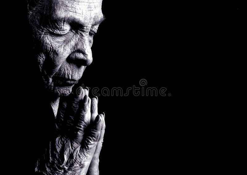 Praying da mulher adulta foto de stock