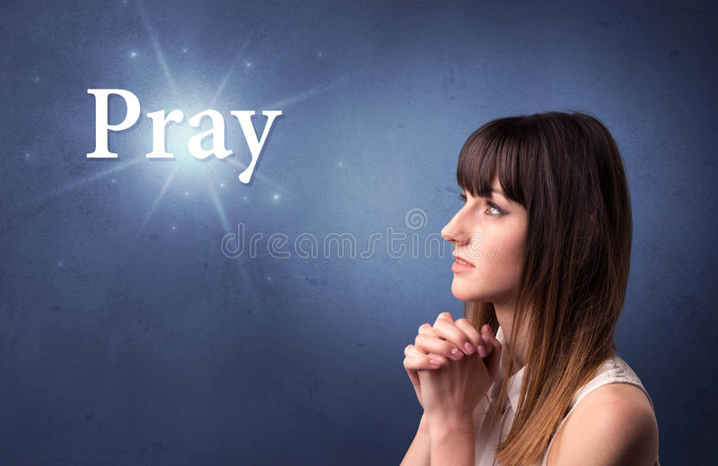 Praying girl concept stock photography