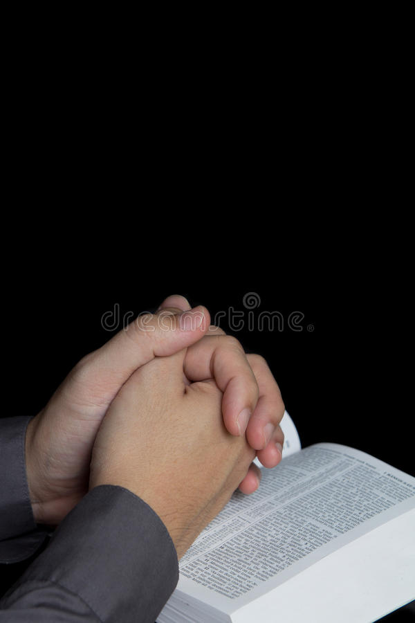 Praying Hand With Holy Bible Stock Images