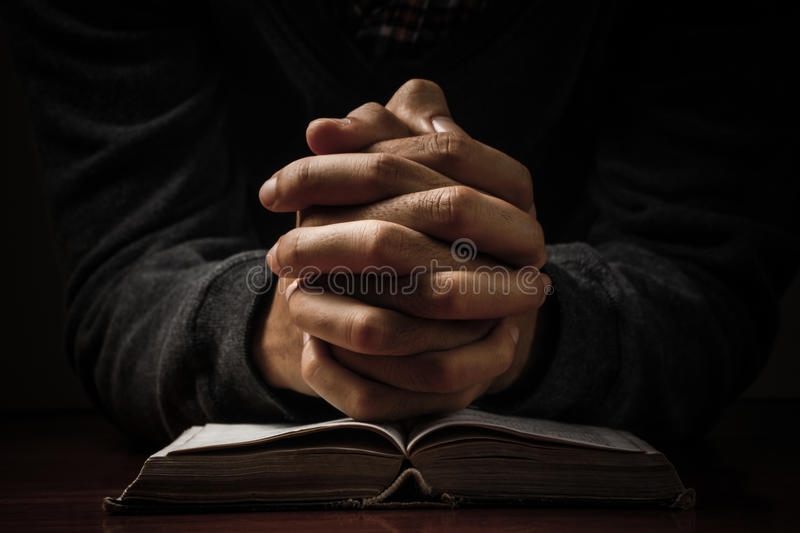 Praying Hands With Bible stock image