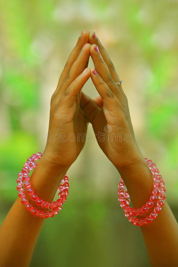 Praying hands of a child stock photos