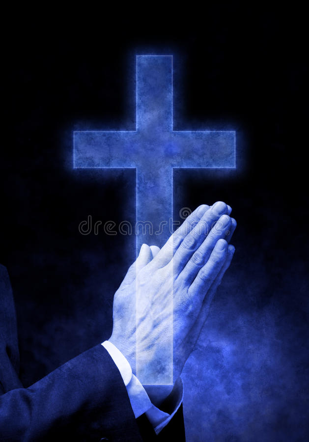 Praying Hands Cross Religion. A mans hands praying with a blue cross overlaid on top royalty free stock photography