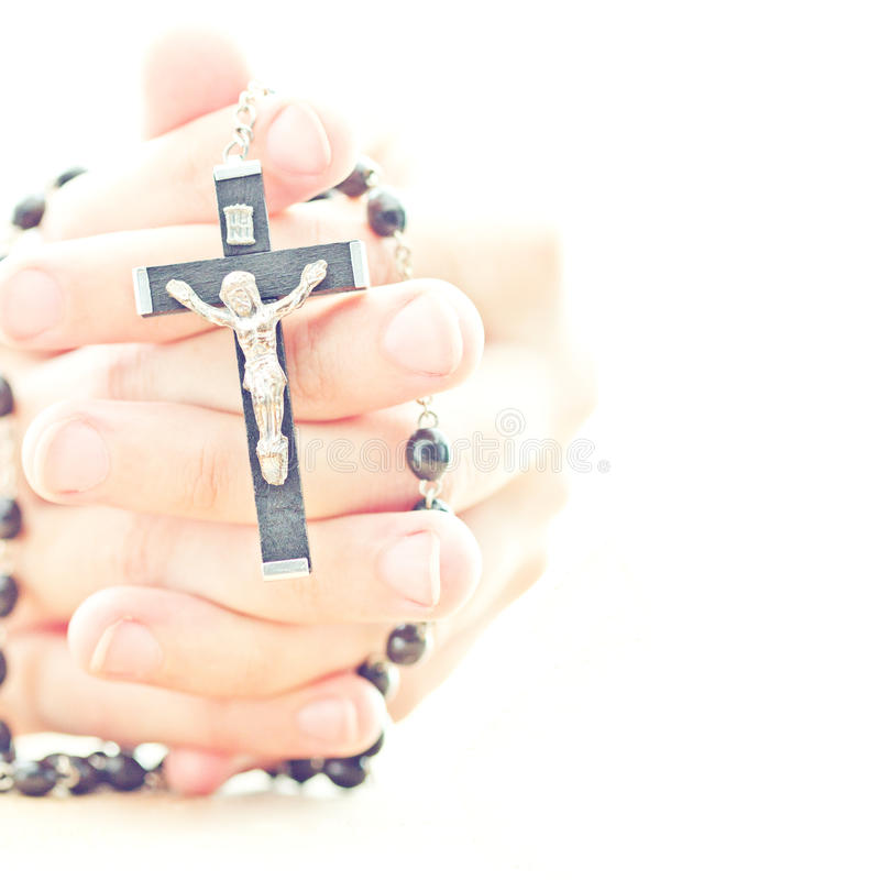 Praying hands with rosary. Praying hands with catholic rosary stock image