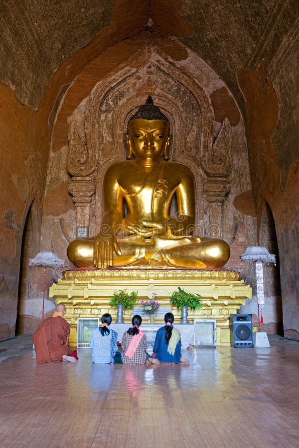 Praying inside htilominlo temple, Bagan. stock photography
