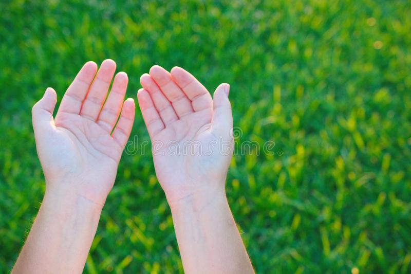 Praying in Islam. Muslims open their hands and prays to God stock image
