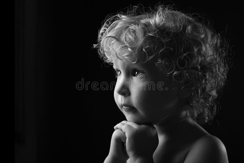 Praying little girl royalty free stock image