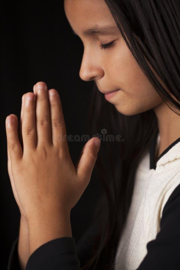 Praying little girl stock image