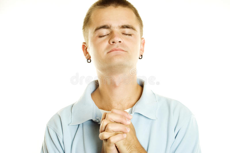 Praying man. Young men put his hands in prayer. Isolated on a white background stock photos