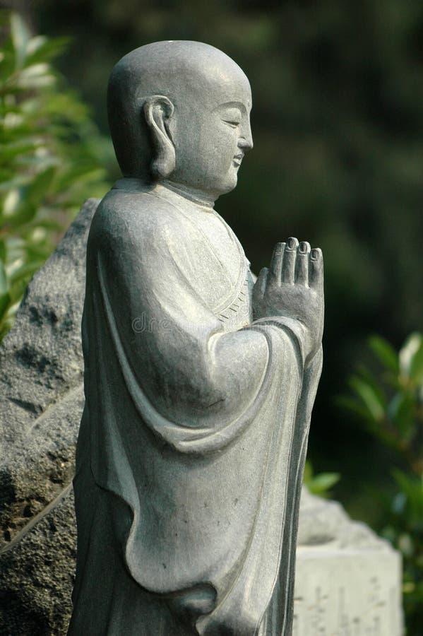 Praying Monk in Xian China stock image