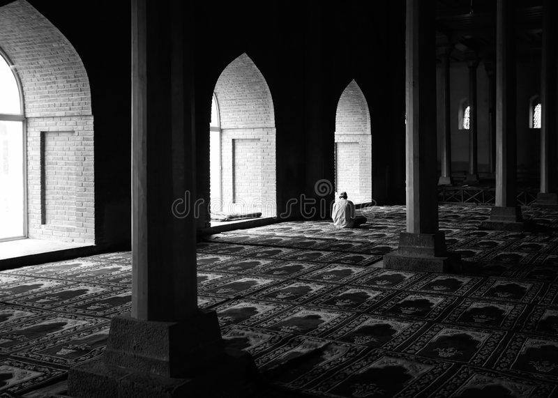 Praying in a Mosque royalty free stock images