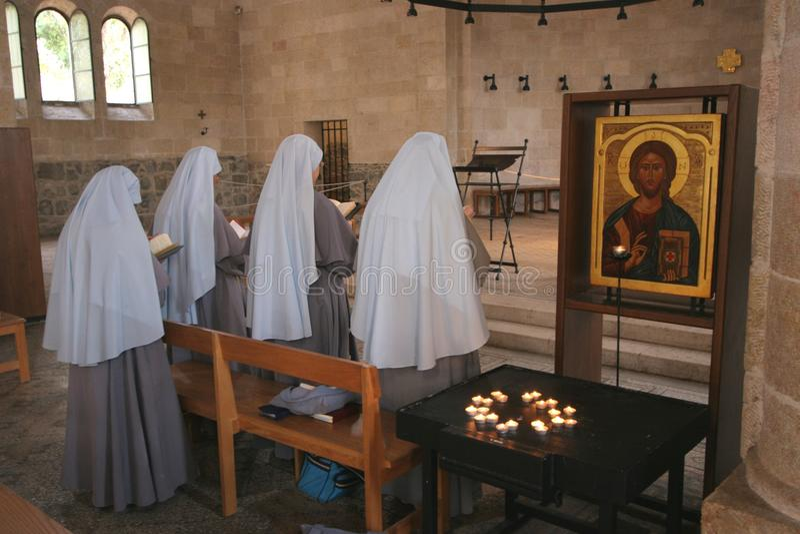 Praying nuns stock photo