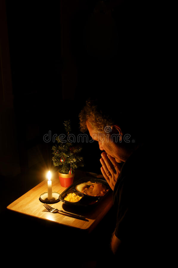 Praying over TV Dinner royalty free stock images
