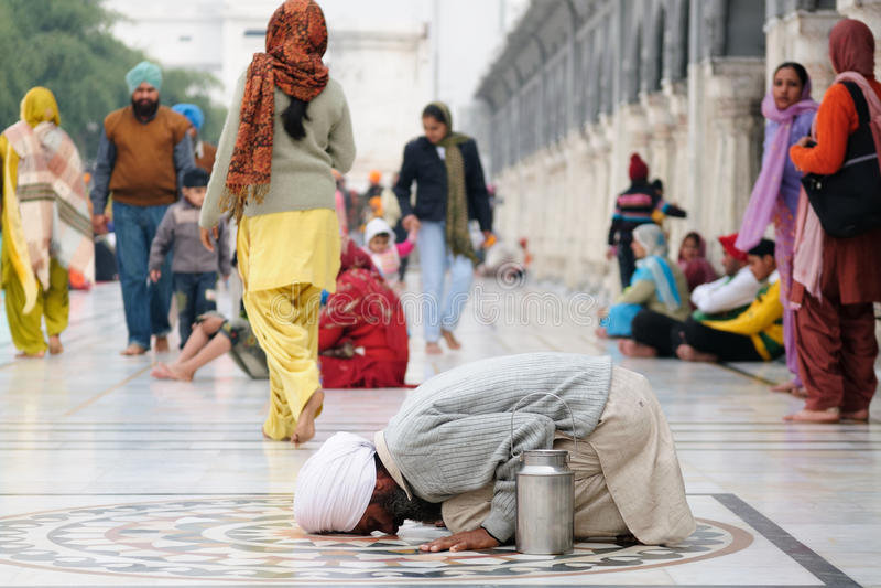 Praying pilgrim in Amritsar. INDIA, AMRITSAR - NOVEMBER 29: Praying pilgrim in the Golden temple (Sri Harimandir Sahib), Amritsar in November 29, 2009 stock photography
